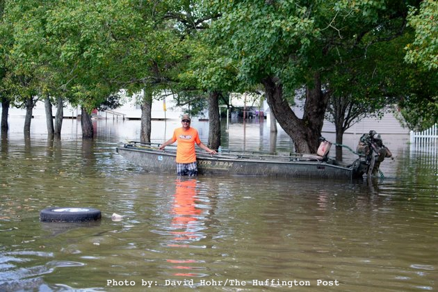 man by boat in high water