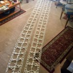 two crochet panels stretched out on floor