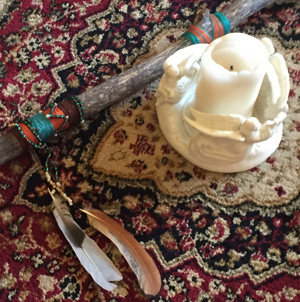 talking stick beside a candle