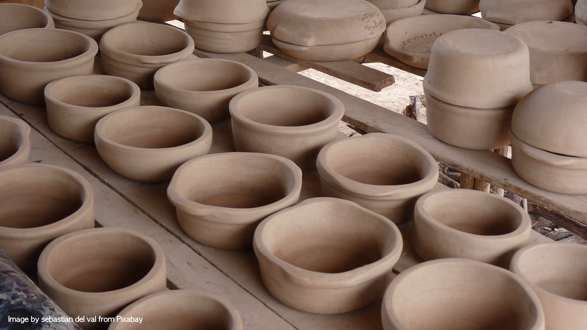 clay pots of all sizes serve as containers to create a fulfilling life